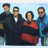 """The Canadians,"" 1994 <br> Oil & digital collage on canvas 40 x 30 inches <br><br> Michael (b.1972), Geoffrey (b.1970), Paula (b.1943), and David Kramer (b.1942)"